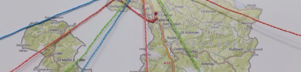 Das Bild zeigt einen Ausschnitt der Karte des Landes Salzburg. Darauf sind Schnüre gespannt