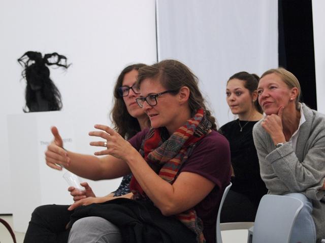 Das Bild zeigt 4 Personen aus dem Publikum